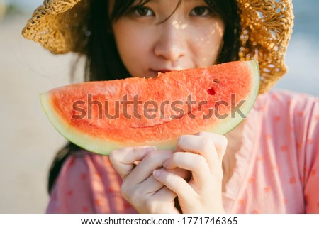 Photo of Cropped image of watermelon in cute girl's hands.