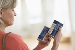 Cropped image of woman comparing products in shop