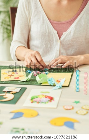 Cropped image of woman enjoying quilling and origami #1097621186