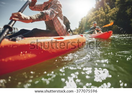 cropped image of woman kayaking ...