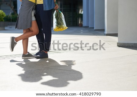Cropped image of young couple kissing outdoors #418029790