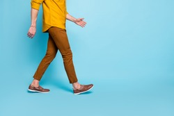 Cropped photo of man going towards empty space in brown shoes trousers pants trendy trend stylish isolated over blue pastel color background