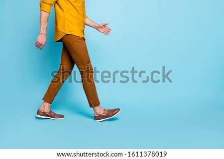 Cropped photo of man going towards empty space in brown shoes trousers pants trendy trend stylish isolated over blue pastel color background ストックフォト ©