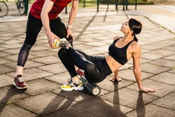 Cropped photo of young sporty couple training together on sportsground