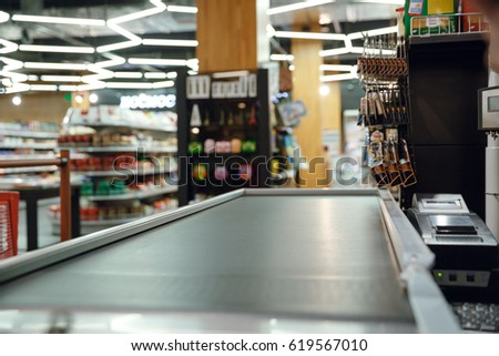 Cropped picture of cashier's desk in supermarket shop