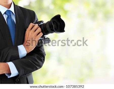 cropped portrait of professional photographer holding dslr camera with copy space