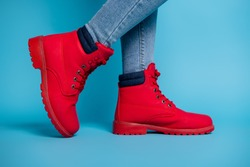 Cropped profile photo of fit lady legs sneaker tiptoe wear stylish red rubber shoes boots denim jeans isolated teal color background