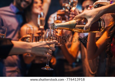 Cropped shot of a group of friends pouring champagne #776413918