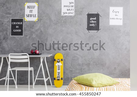 Cropped shot of a teenager room interior with a minimalistic desk and a single bed