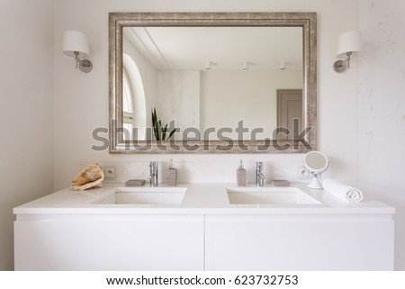 Cropped shot of a white vanity top with two sinks and a stylish mirror in bathroom interior