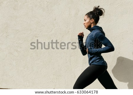 Cropped shot of a woman running in the city