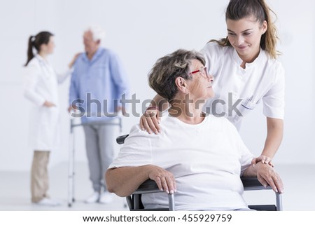 Cropped shot of a young nurse taking care of her patient in a wheelchair