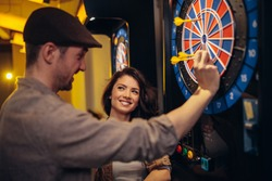 Cropped shot of an attractive couple playing darts