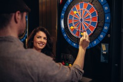 Cropped shot of an attractive young couple playing darts