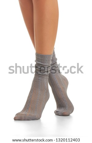 aac6e66f6d6174 Cropped shot of lady's legs wearing pair of anthracitic lace loose socks,  standing on tiptoe