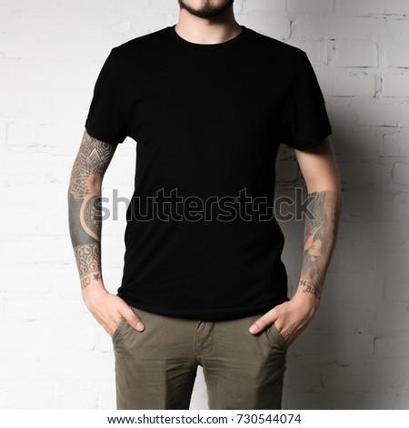 cropped shot of man in blank black t-shirt