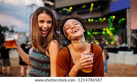 Cropped shot of two young female friends at a music festival