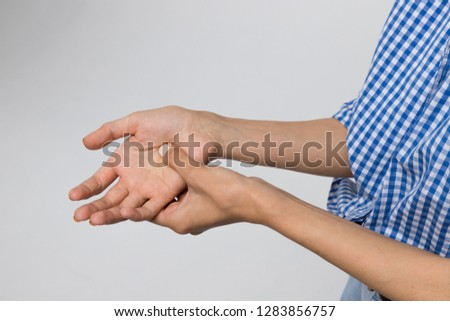 Cropped shot of woman suffering from pain in arms, weakness and tingling in hand/osteoarthritis, rheumatoid arthritis, wrist sprain, carpal tunnel syndrome, fractures. Healthcare and medicine concept #1283856757