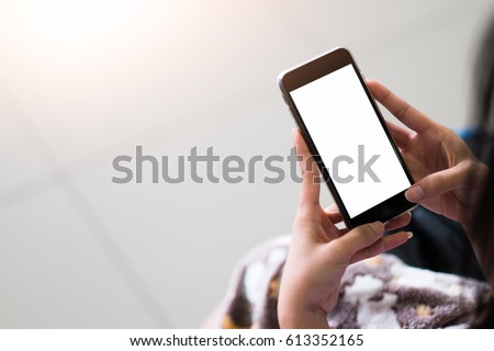 Cropped shot view of woman's hands holding smart phone with blank copy space screen for your text message or information content, female reading text message on cell telephone during in urban setting