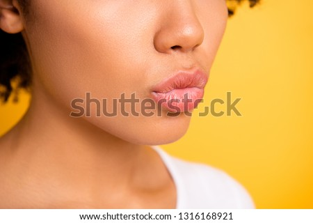 Cropped side profile close up photo beautiful she her dark skin lady send kisses perfect mouth lips naturally balm aesthetic look wear casual white t-shirt isolated yellow bright vibrant background
