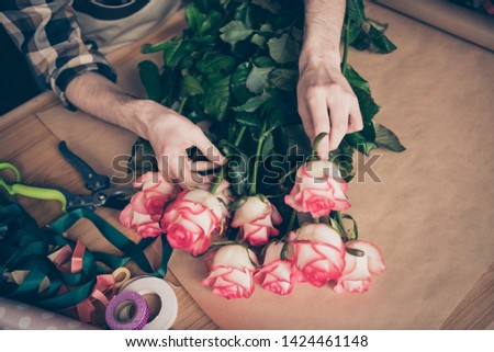 Cropped top above high angle view photo of hands hold touch botany environment assortment amke surprise small business representative rosebud wear checked clothing youth greenhouse desk desktop #1424461148