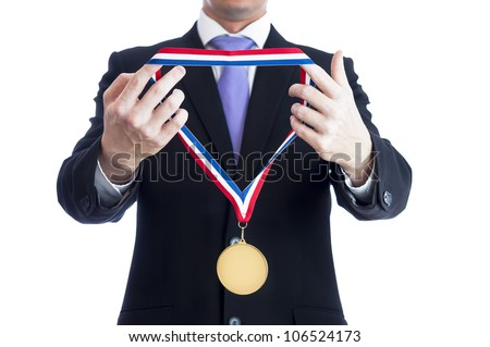 Cropped torso of man wearing black suit and awarding blank sports gold medal.