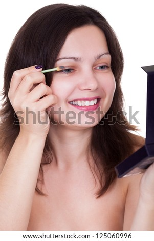 Cropped view image of an attractive woman applying mascara to her eyelashes