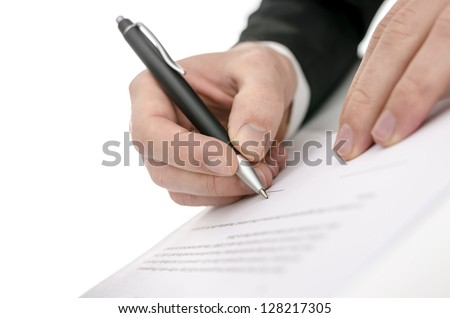 Cropped view of a business man signing a contract. Shallow focus on signature.