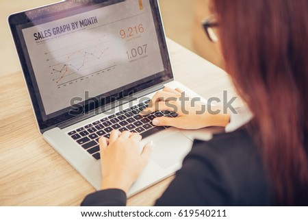 Cropped View of Business Lady Working on Laptop