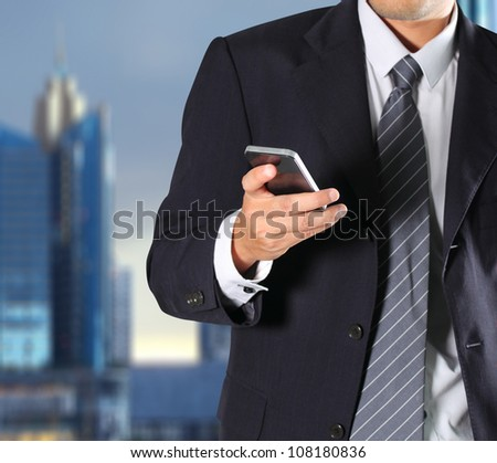 Cropped view of Businessman holding the phone