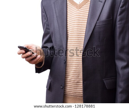 Cropped view of Businessman holding the phone standing in front the major cities