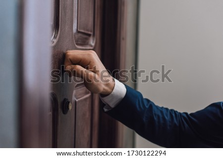 Cropped view of collector knocking on door with hand Foto d'archivio ©