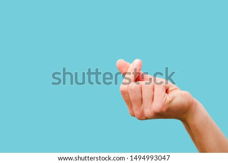 cropped view of female hand snapping fingers isolated on blue #1494993047