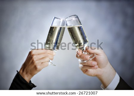cropped view of heterosexual couple toasting. Copy space