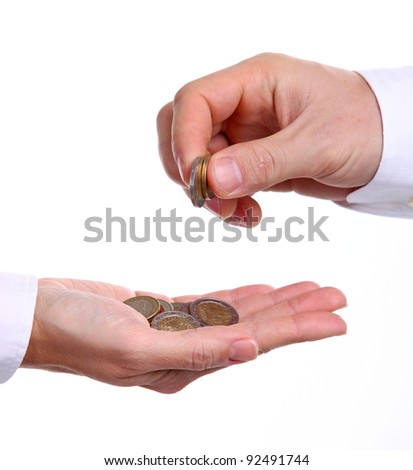 Cropped view of male hand giving euro coins to another person