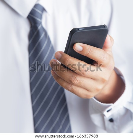 Cropped view of man using mobile phone  #166357988