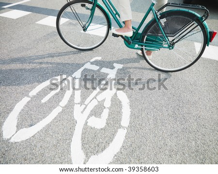 cropped view of woman commuting on bicycle. Copy space
