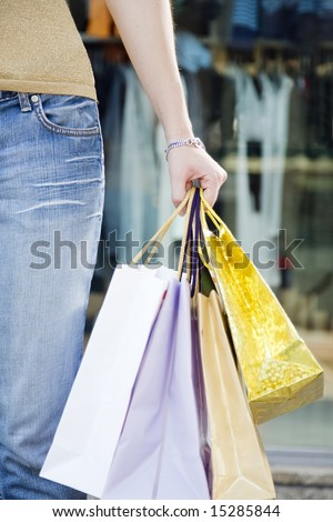 Cropped view of woman holding shopping bags