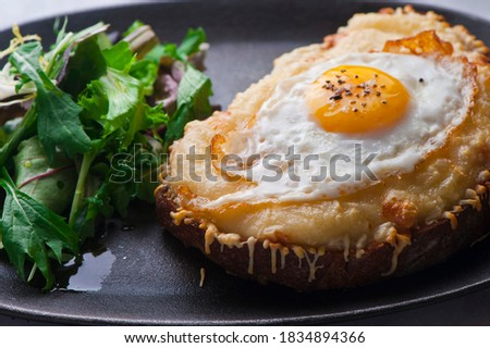 Croque madame or monsieur. Breakfast or brunch favorite: toast, with fried eggs, ham, cheese, and hollandaise sauce. Served with potato hash. Classic French bistro or American restaurant entree. Photo stock ©