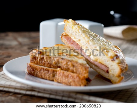 Croque Monsieur - most known French toast with Ham and Cheese served on white plate front view Photo stock ©