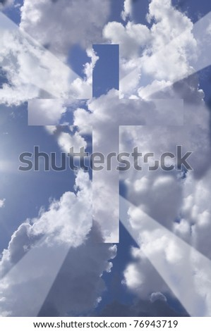 Cross against blue sky with dramatic clouds and rays of light