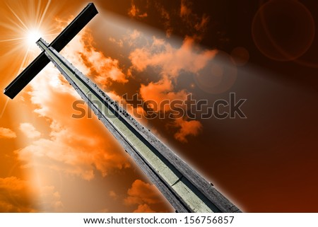 Cross Against the Orange Sky / Wooden high cross with red and orange sky, clouds and rays