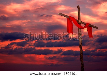 Cross and red tunic on a colorful sunset background