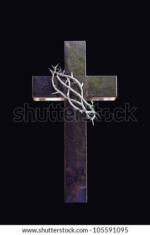 Cross and thorns isolated in black