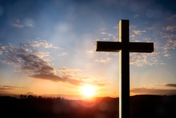 Cross at sunset, crucifixion of Jesus Christ
