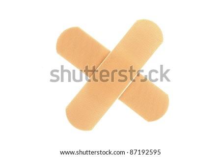 Cross Bandaid isolated on white background