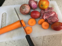Cross contamination of food, meat and vegetables on the same chopping board