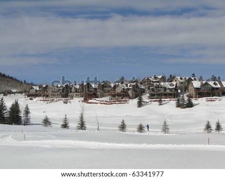 Cross country skiers skate across snowy meadows Colorado