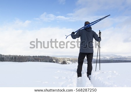 Cross-country skiing man doing classic nordic cross country skiing in winter #568287250