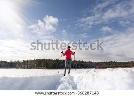 Cross-country skiing woman doing classic nordic cross country skiing in winter #568287148